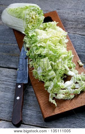 Sliced Cabbage And Knife On A Rustic Table