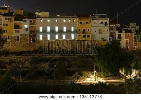 The skyline of Villajoyosa in Spain with multicolored houses at night