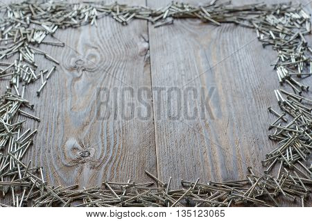 nail heads. hobnails on the wooden table