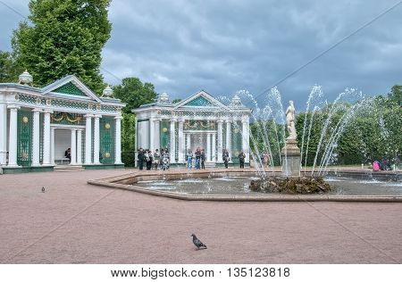 PETERHOF, SAINT-PETERSBURG, RUSSIA - JUNE 25, 2014: The Lower Park. Tourists  near Eve Fountain and trellis pavilions. Peterhof is The State Museum Preserve