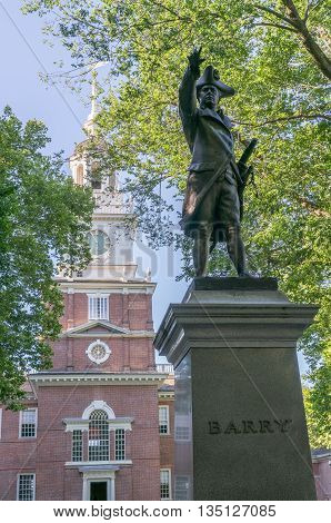 Independence Hall in Philadelphia Pennsylvania with Commodore Barry statue in foreground.