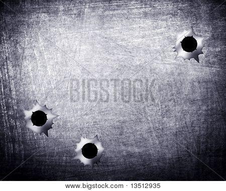 bullet holes in metal plate
