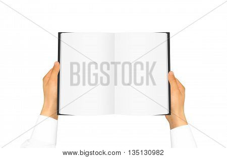 Hand in white shirt sleeve holding blank book in the hand. Black cover brochure presentation. Pamphlet hand man. Man show pages. Sheet template. Booklet in hands. Book design. Catalog sheet display.
