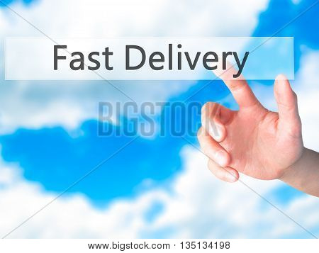 Fast Delivery - Hand Pressing A Button On Blurred Background Concept On Visual Screen.