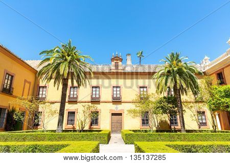 Seville, Spain- Jun 4: Exterior shot of Royal Alcazars of Seville on Jun 4, 2014. Royal Alcazars of Seville is the oldest royal palace still in use in Europe.