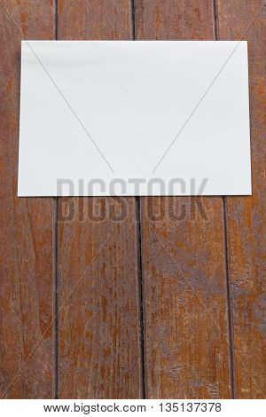 white paper on a wood tenture background