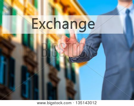 Exchange - Businessman Hand Pressing Button On Touch Screen Interface.