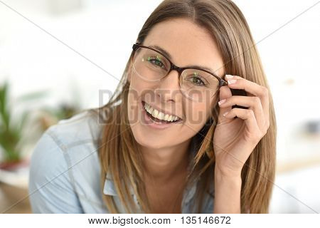 Portrait of beautiful young woman with eyeglasses