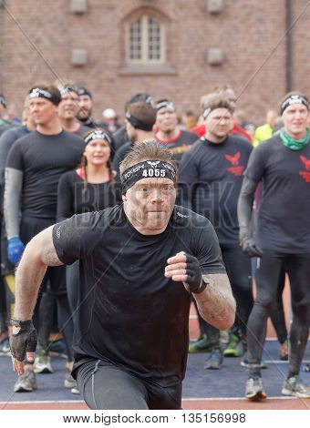 STOCKHOLM SWEDEN - MAY 14 2016: Man sprinting towards the rampage obstacle in the obstacle race Tough Viking Event in Sweden May 14 2016