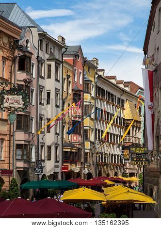 INNSBRUCK AUSTRIA - 18TH JUNE 2016: Restaurants and patios along Herzog Friedrich Strasse in the central district of Innsbruck during the day.