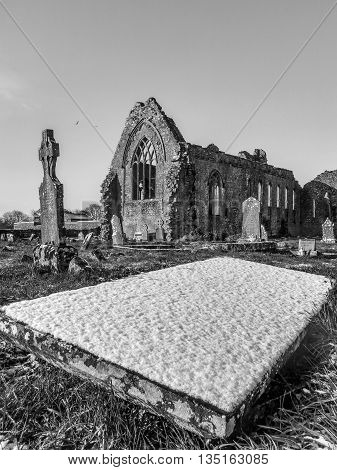 Winter in Athenry dominican abbey with tombstone, Ireland