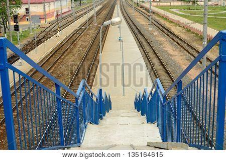 Byelorussia.City Buda-Koshelevo.Railway Platform in the city.Upstairs is a pedestrian crossing across the platform.