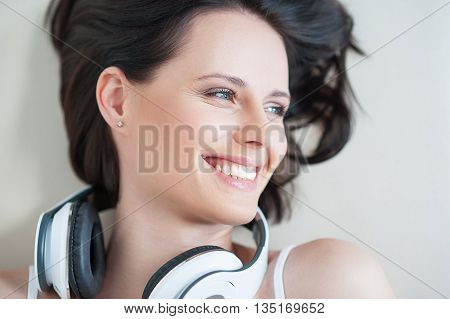 Music is her life. Top view of pretty woman with headphones, with copyspace