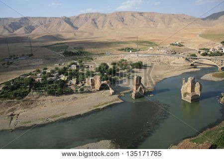 Turkey. Hasankeyf village (Southeastern Anatolia). Aerial view from the Fortress on the Tigris River with remains of the Old Bridge