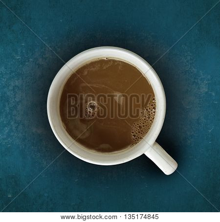 Coffee put on dark blue wooden background.