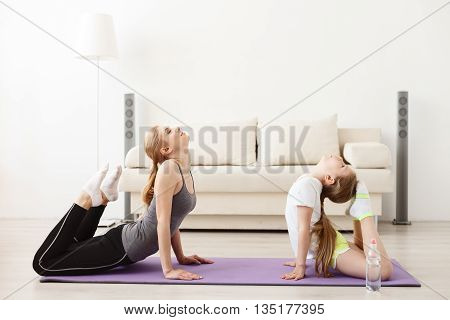Yoga has no age restriction. Full length shot of mother and daughter doing yoga together