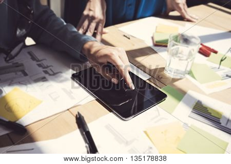 Woman Touch Display Digital Tablet Hand.Project . Business Team Working Startup. Using electronic devices, papers, notes wood table.Blurred