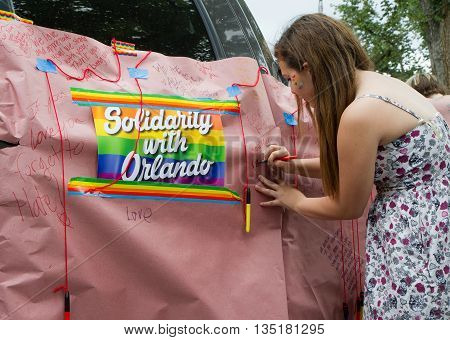 Boise, Idaho/usa - June 20, 2016: Woman Signing A Banner In Honor Of Those Of The Orlando Shooting