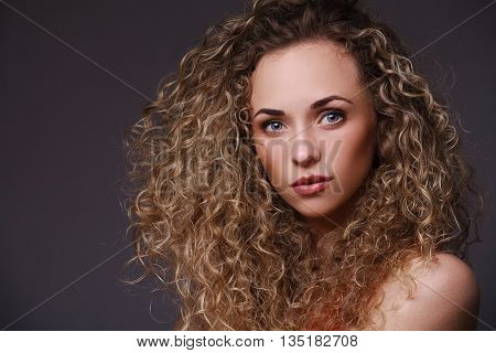 Closeup portrait of woman with curly hair. Thinking about. Sensual portrait