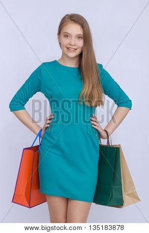 Young attractive girl with colorful shopping bags isolated on white background