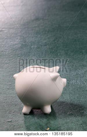 white piggy bank on the blackboard