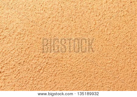 Orange stucco plaster texture surface with light