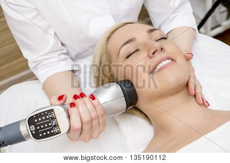 Female taking a facial massage in the spa salon