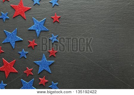 Red and blue stars on slate background