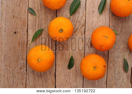 Fresh oranges fruits on a wooden background