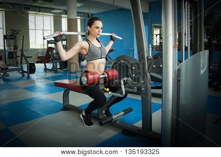 beautiful athletic woman working ab intervals in fitness