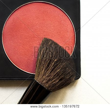 Dry textured correcting blusher and brush on white background. Makeup tool. Professional cosmetics.
