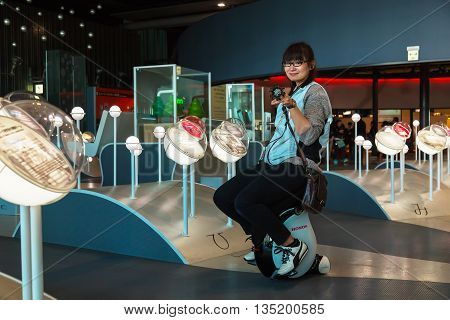 TOKYO JAPAN - NOVEMBER 27 2015: Unidentified Japanese staffs at The National Museum of Emerging Science in Odaiba area