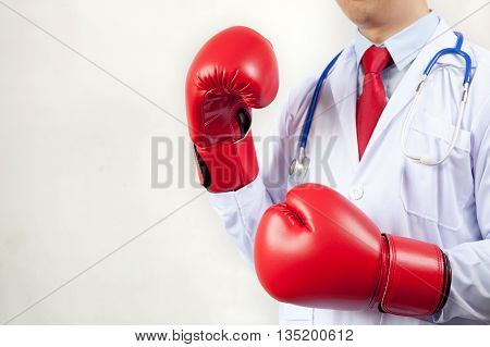 Doctor Wearing Boxing Gloves In White Background