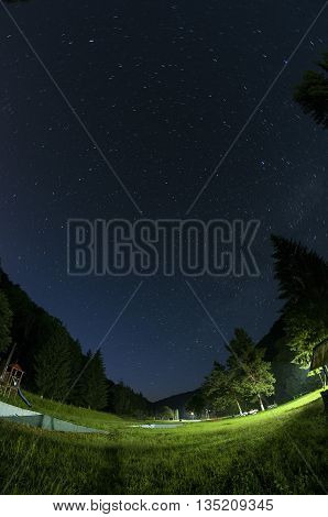 Fisheye view of a camp. Summer camp for kids. Stars