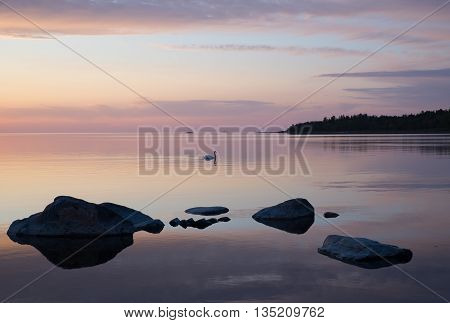Rocky east coast at sea archipelago in sunset