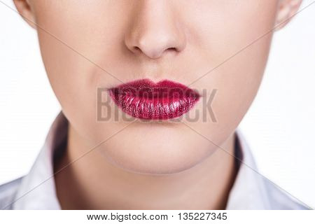 Beautiful woman lips with bright lipstik on the white background