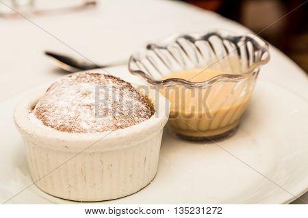 Souffle with Powdered Sugar and Cream Sauce in Ramekins