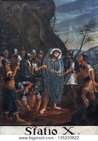 KOTARI, CROATIA - SEPTEMBER 16: 10th Stations of the Cross, Jesus is stripped of His garments, Church of Saint Leonard of Noblac in Kotari, Croatia on September 16, 2015.