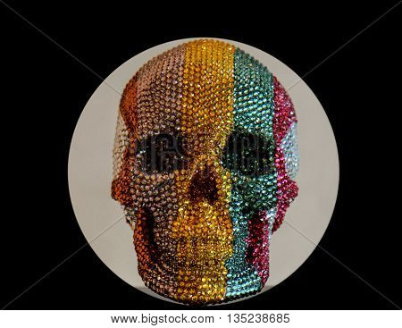 Jewel encrusted skull in yellow,green,red and silver