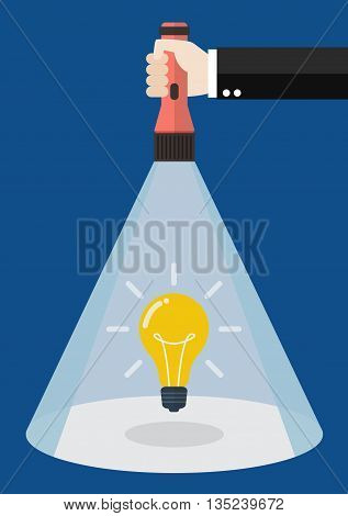 Hand holding flashlight glow to lightbulb idea. Search in business