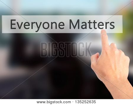Everyone Matters - Hand Pressing A Button On Blurred Background Concept On Visual Screen.
