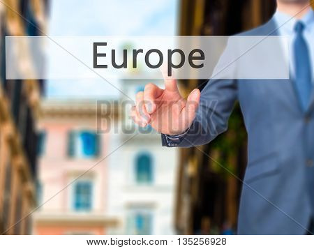 Europe - Businessman Hand Pressing Button On Touch Screen Interface.