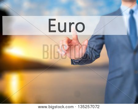 Euro - Businessman Hand Pressing Button On Touch Screen Interface.