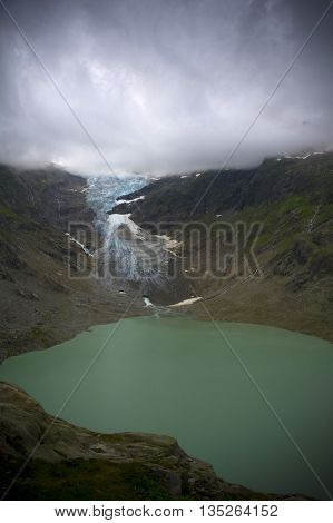 trift lake in swiss alps during summer