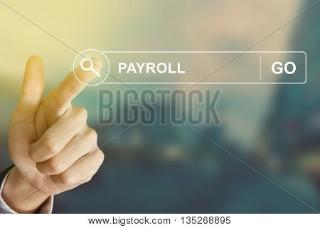 business hand clicking payroll button on search toolbar with vintage style effect