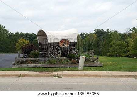 SHOREWOOD, ILLINOIS / UNITED STATES - AUGUST 21, 2015: A covered wagon advertises Skooter's Roadhouse Restaurant in Shorewood.