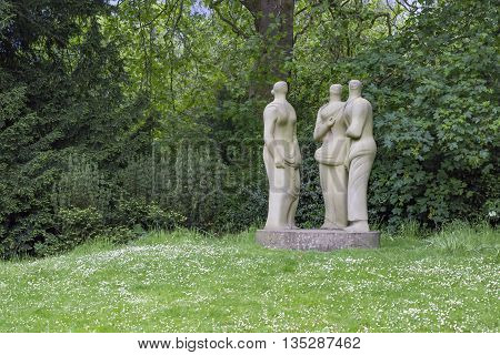 London England - May 22 2016: Henry Moore sculpted the Three Standing Figures in 1947 and it has been exhibited in Battersea Park London ever since.