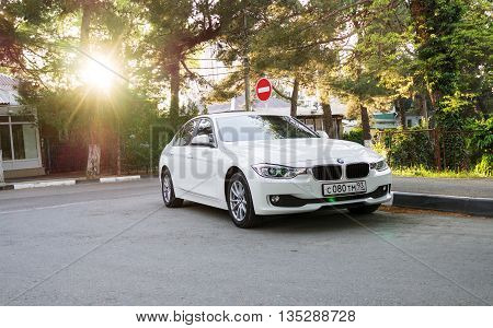 SOCHI RUSSIA - APRIL 29 2016: BMW 525 parked on the streets of Sochi. BMW is a German automobile company founded in 1916. BMW 525 in sunlight