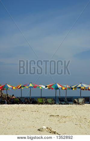 Umbrellas On The Beach Sands Of A Beach.