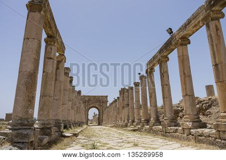 Columns In Colonnaded Street And Northern Tetrapylon At Background, Ancient Roman City Of Gerasa Of